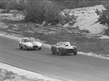 1963 Shelby 289 Cobra Works  - $Ken Miles and CSX 2129 ahead of Briggs Cunningham in the #60 Jaguar E-Type at the Bridgehampton Double 500, September 1963.