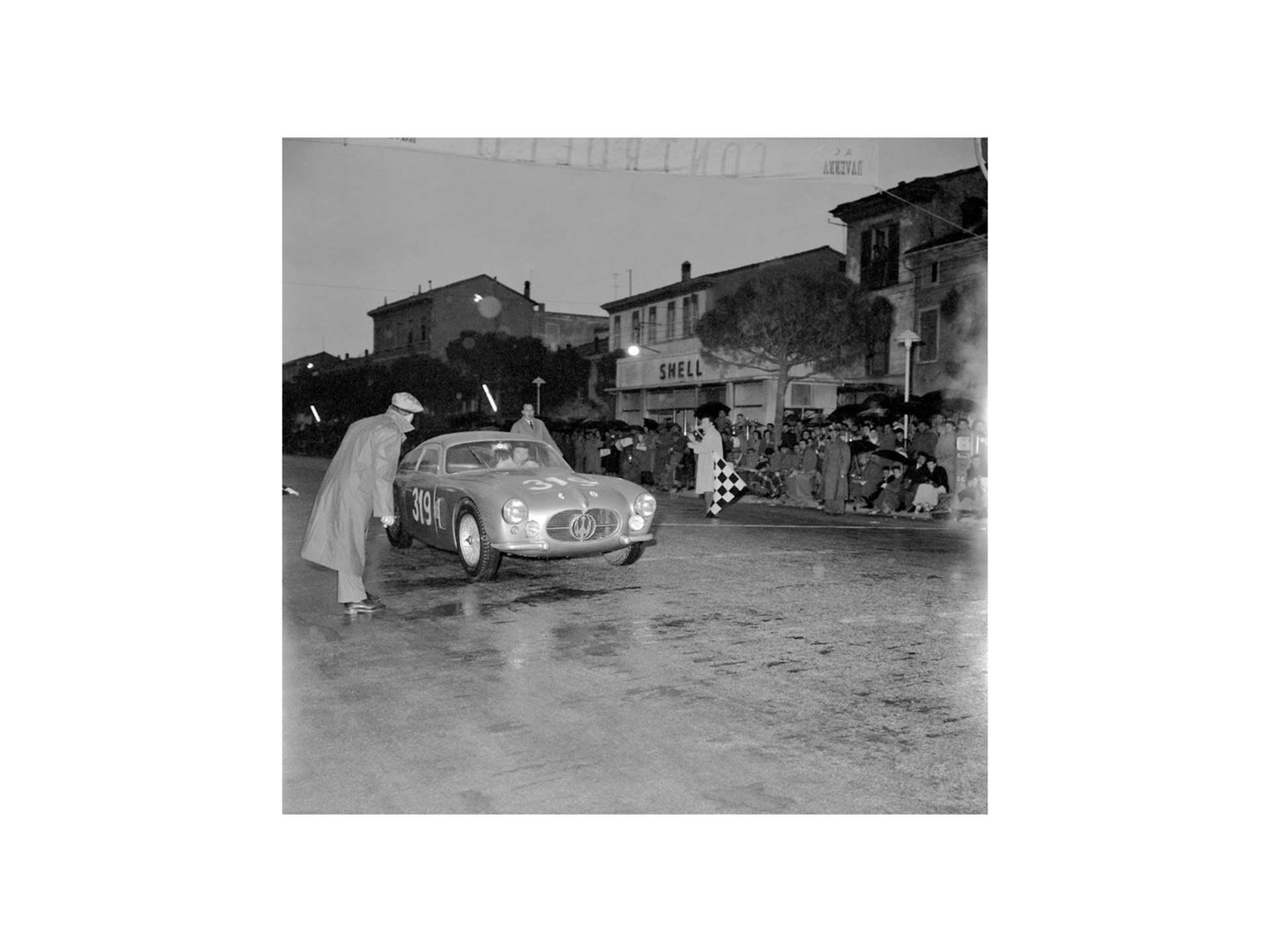 Chassis no. 2124 reaches the checkpoint at Ravenna during the 1956 Mille Miglia.