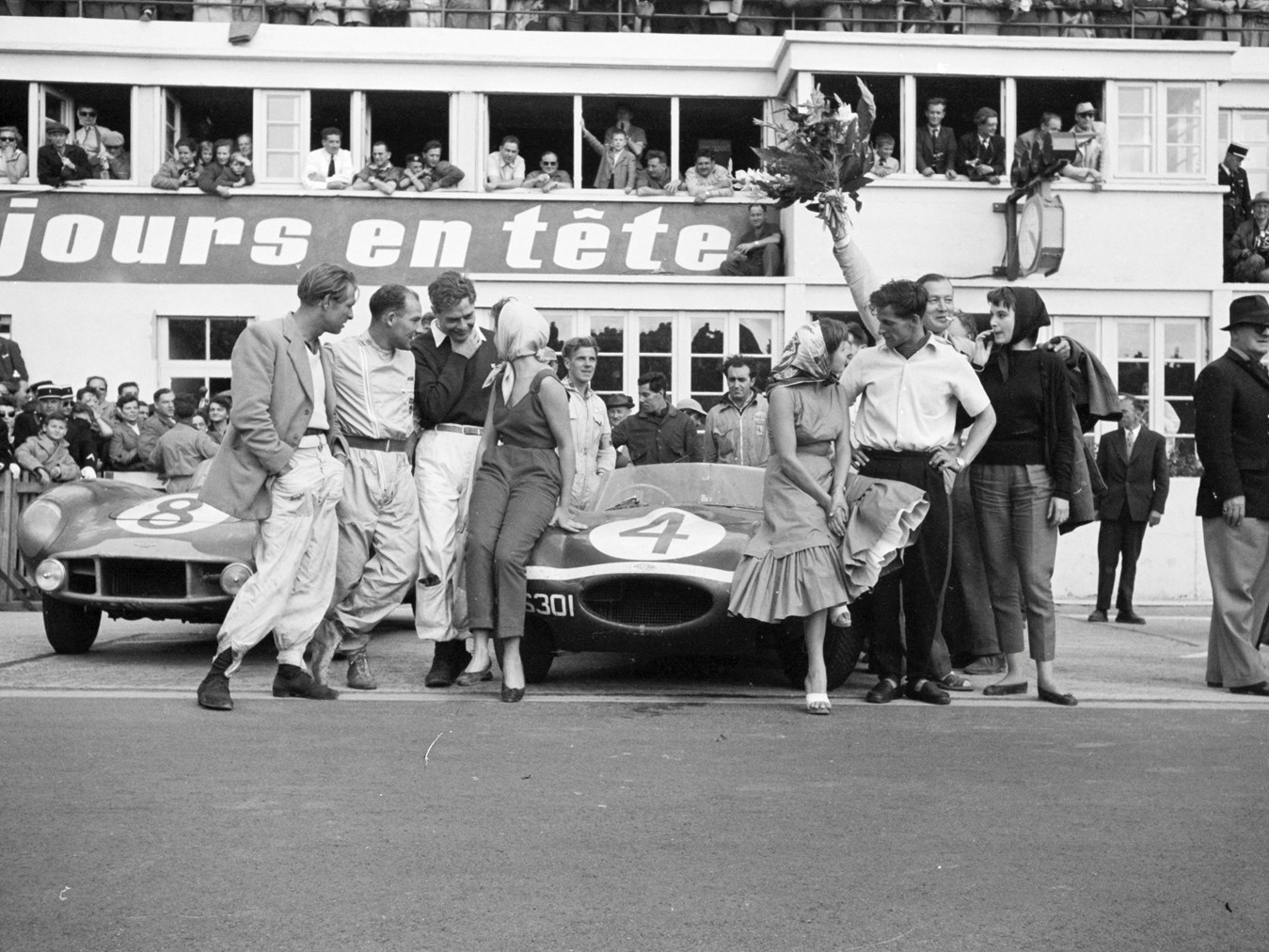 Chassis no. XKD 501 pictured at the finish of the 1956 24 Hours of Le Mans along with the 2nd place Aston Martin DB3S of Sir Stirling Moss and Peter Collins.