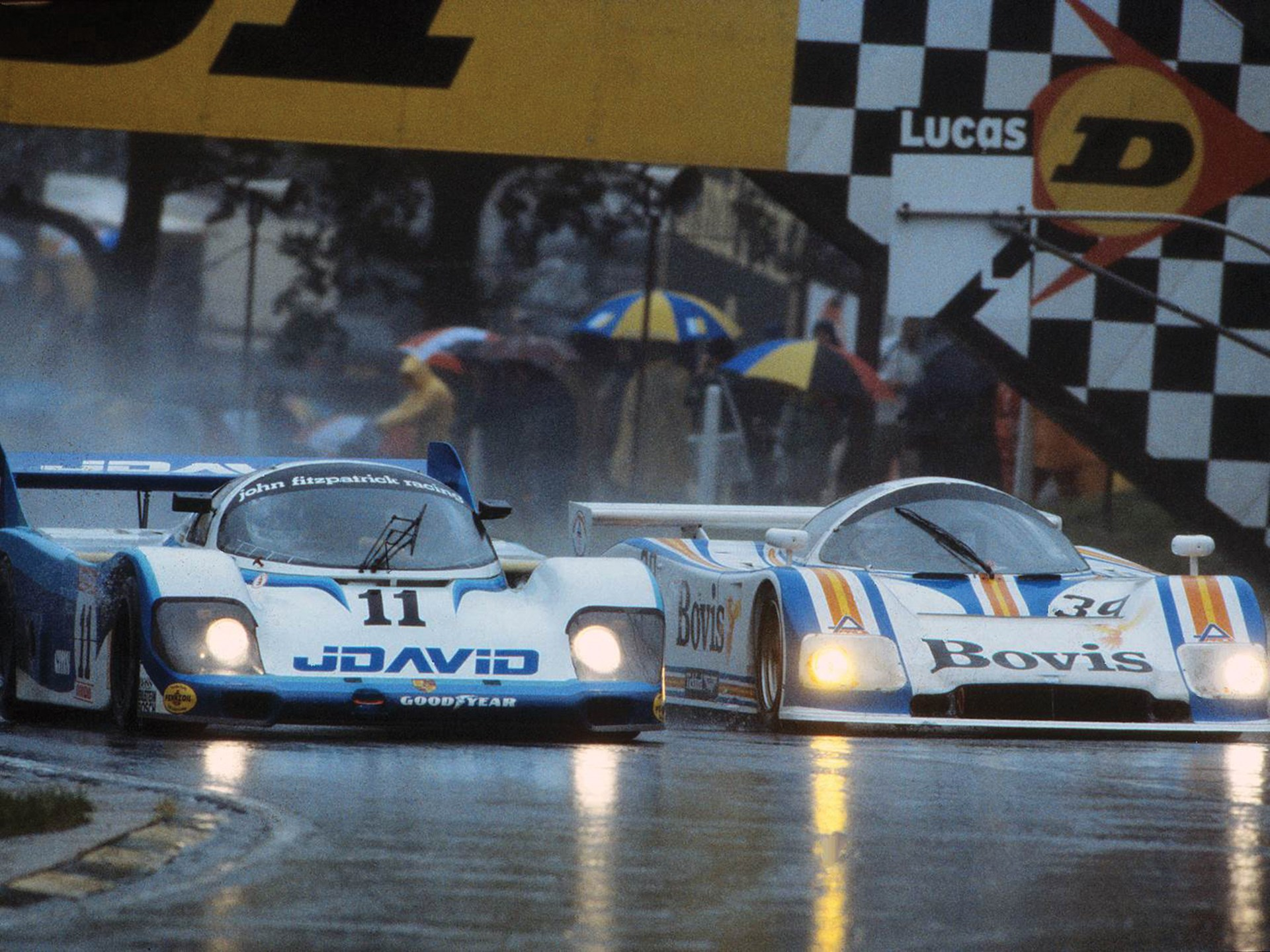 Chassis 956-110 dominates in the rain at the Brands Hatch 1000 KM in 1983.