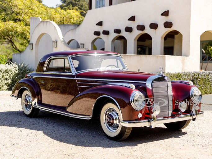 Mercedes 300 SC in metallic maroon at the Scott Grundfor Company. March 3, 2020.