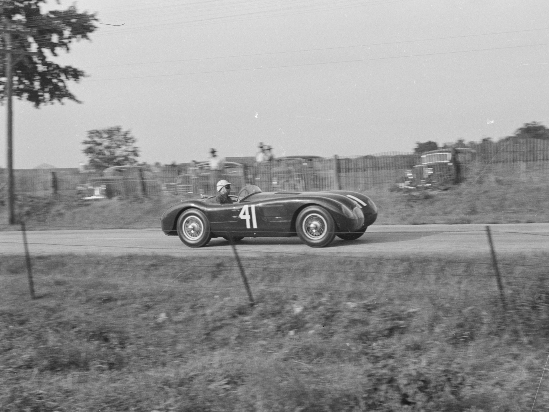 Phil Hill at the wheel of XKC 007 en route to victory at Elkhart Lake in September of 1952, the first race win for a C-Type in the United States.