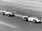 """1961 Ewing """"Dean Van Lines Spl."""" Indianapolis Roadster  - $Eddie Sachs leads A.J. Foyt in the 1961 Indianapolis 500, only to finish 2nd to Foyt after having to pit for a new tire with three laps to go."""