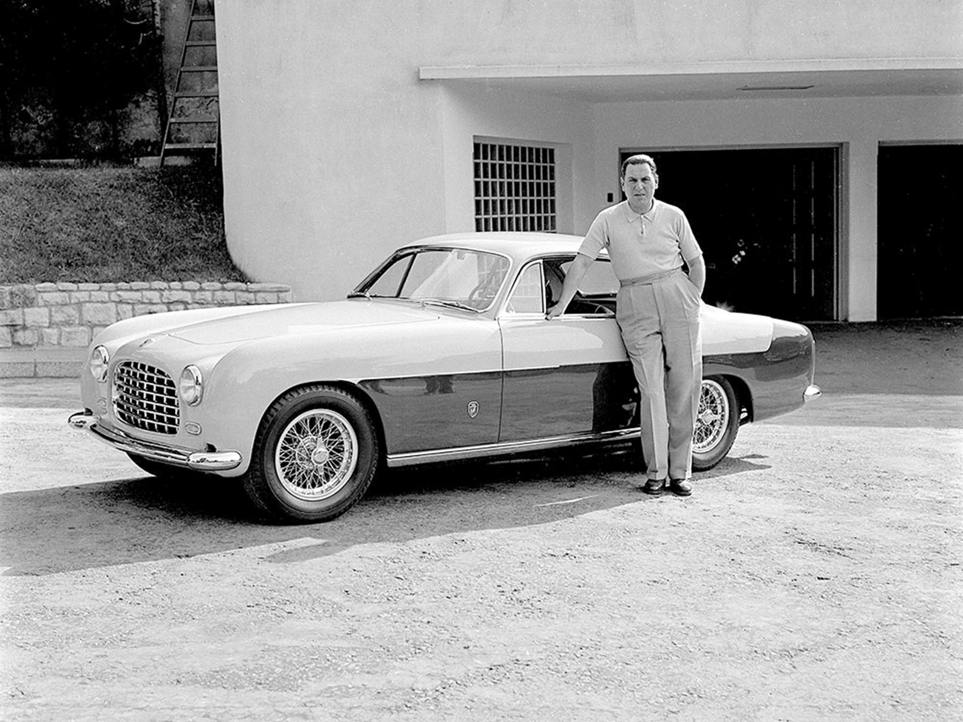 Argentinian President Juan Perón poses with his 212 Inter, believed to be outside of Casa Rosada in Buenos Aires.