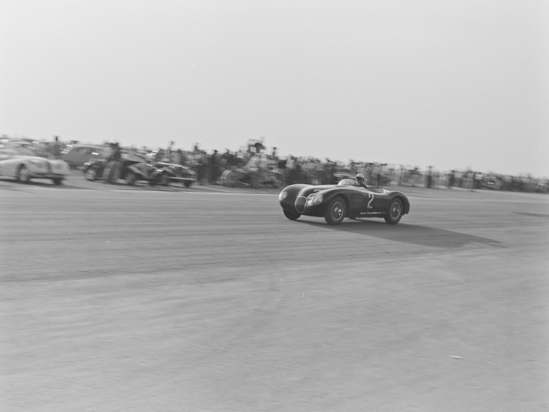 Phil Hill racing XKC 007 in late 1952, believed to be at Madera Airport in California.