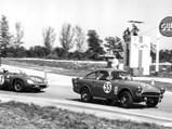 1961 Sunbeam Harrington Alpine NART Coupe  - $The Sunbeam Harrington Alpine NART leads a Ferrari 268 SP out of a corner at the 1963 12 Hours of Sebring.