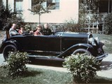 """1929 Chrysler 75 Roadster  - $A young Dick Roy with his sister, Peg, and their parents, Ernest and Helen, in """"Blossom""""."""