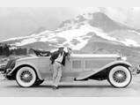 1930 Isotta Fraschini Tipo 8A S Boattail Cabriolet by Castagna - $Visibly exhilarated from his ascent of Mt. Hood, Sergio Franchi poses proudly with the jewel of his collection.