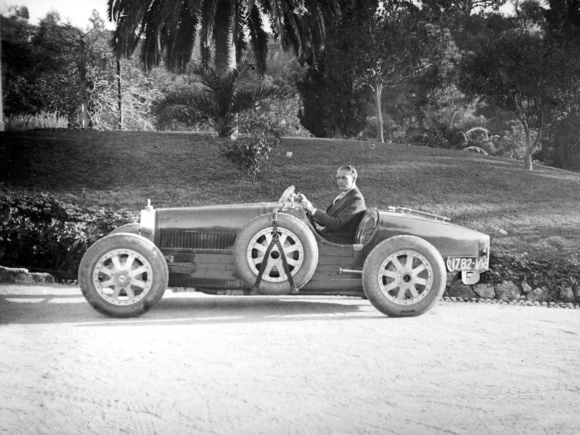 Lord Cholmondeley pictured with his Bugatti shortly after delivery in 1925 (note the temporary French registration plates).