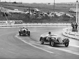 1929 Alfa Romeo 6C 1750 Super Sport  - $Hugh Gearing and his beloved 6C 1750 outpaces a Bugatti at an event at Kyalami, ca. 1970s.